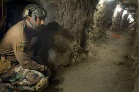 US Border Patrol studies drug smuggling tunnels on San Diego Tijuana border