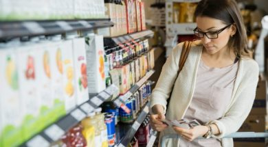 woman-shopping-with-coupons-in-market-1-580×386