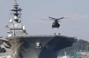 FILE PHOTO: A helicopter lands on the Izumo, Japan Maritime Self Defense Force's (JMSDF) helicopter carrier, at JMSDF Yokosuka base in Yokosuka